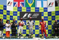 Podium: race winner Rubens Barrichello, BrawnGP, second place Lewis Hamilton, McLaren Mercedes, thir