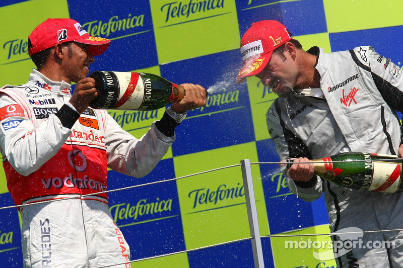 Podium: champagne celebration for race winner Rubens Barrichello, BrawnGP, second place Lewis Hamilt