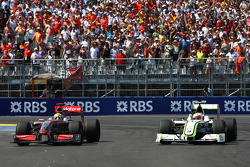 Lewis Hamilton, McLaren Mercedes and Rubens Barrichello, Brawn GP