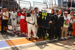 Brawn GP team members wait for race winner Rubens Barrichello