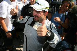 Race winner Rubens Barrichello, BrawnGP celebrates with his team