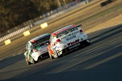 Garth Tander chases Fabian Coulthard