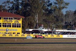 Jamie Whincup takes the chequered flag