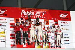 GT500 podium: class and overall winners Hiroaki Ishiura and Kazuya Oshima, second place Ronnie Quintarelli and Hironobu Yasuda, third place Yuji Tachikawa and Richard Lyons