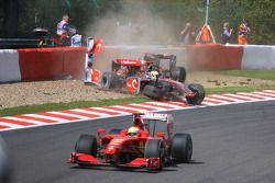 Lewis Hamilton, McLaren Mercedes and Jaime Alguersuari, Scuderia Toro Rosso crashes in the first lap