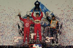 Ryan Briscoe, Team Penske on the podium with Scott Dixon, Target Chip Ganassi Racing and Mario Morea