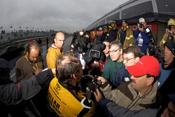 Jacques Villeneuve talks to the media