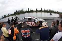Fans watch as Brad Coleman heads back to his garage