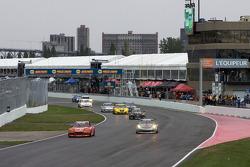GT start: #30 Racers Edge Motorsports Mazda RX-8: Dane Cameron, Tom Sutherland, Doug Peterson and #87 Farnbacher Loles Racing Porsche GT3: Leh Keen, Dirk Werner lead the field