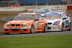 Colin Turkington leads Jonny Adam