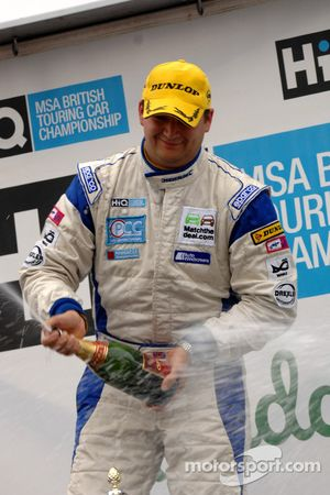 Mat Jackson sprays Champagne