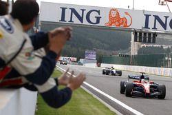 Giedo Van der Garde crosses the line to take victory