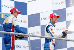 Giedo Van der Garde celebrates his victory on the podium with Roldan Rodriguez