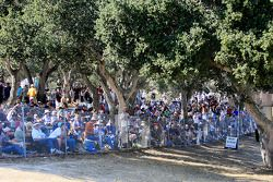 A large crowds enjoys the racing action from the corkscrew