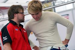 Jack Clarke talks with a mechanic