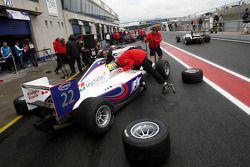 Andy Soucek changes onto slicks during qualifying