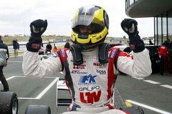 Race winner Andy Soucek celebrates in parc fermé