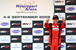Kazim Vasiliauskas celebrates on the podium after finishing 3rd
