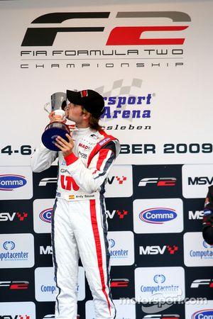 Andy Soucek celebrates on the podium after finishing 1st