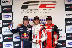 Mirko Bortolotti, le vainqueur Andy Soucek et Kazim Vasiliauskas sur le podium