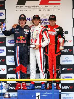 Mirko Bortolotti, Race winner Andy Soucek and Kazim Vasiliauskas on the podium