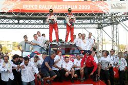 Podium: provisional winners and final second Sébastien Loeb and Daniel Elena celebrate with their te