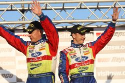 Podium: provisional second and final winners Mikko Hirvonen and Jarmo Lehtinen