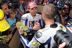 Race winner Valentino Rossi, Fiat Yamaha Team celebrates with second place Jorge Lorenzo, Fiat Yamah