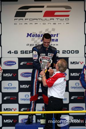 Mikhail Aleshin and Jonathan Palmer Motorsport Vision Chief Executive on the podium