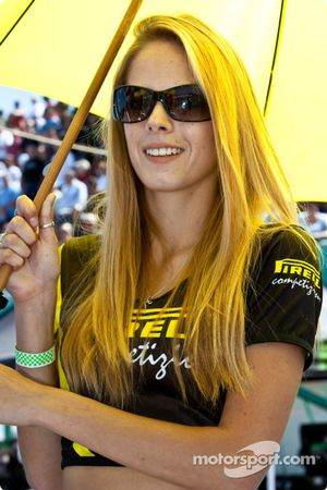 A Pirelli umbrella girl on pit road