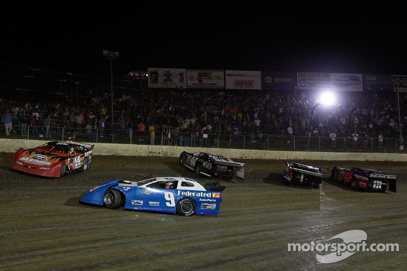 Ken Schrader, driver of the #9 and Joey Logano, driver of the #14 spin out in turn three