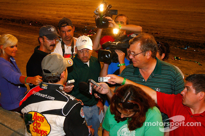 Tony Stewart, driver of the #14 Bass Pro Shops Chevrolet speaks with the media after winning
