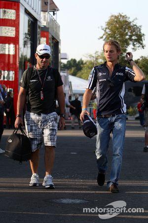 Rubens Barrichello, BrawnGP, Nico Rosberg, WilliamsF1 Team