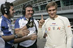 Vitaly Petrov celebrates his pole position with his team