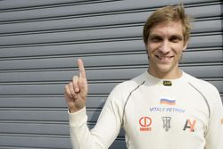 Vitaly Petrov celebrates his pole position