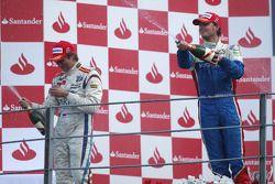 Podium: race winner Giedo Van der Garde, and second place Vitaly Petrov celebrate