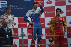 Podium: race winner Giedo Van der Garde, second place Vitaly Petrov, third place Lucas Di Grassi
