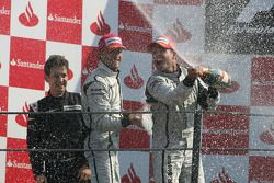 Podium: race winner Rubens Barrichello, BrawnGP, second place Jenson Button, BrawnGP