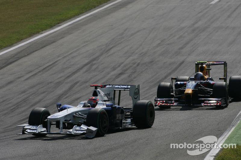 Robert Kubica, BMW Sauber F1 Team and Sebastian Vettel, Red Bull Racing