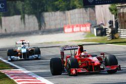 Kimi Raikkonen, Scuderia Ferrari and Adrian Sutil, Force India F1 Team