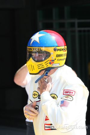 Johnny Rutherford straps in for another run in the iconic Chaparral