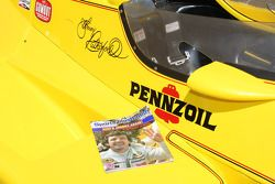 The 1980 Sports Illustrated issue featuring Johnny Rutherford on the cover after earning his third Indianapolis 500 victory rests on the sidepod of the car he drove to that dominant win, the Chaparral
