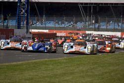 Start: #007 Aston Martin Racing Lola Aston Martin: Jan Charouz, Tomas Enge, Stefan Mücke leads #10 T