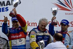 LMP1 podium: class and overall winners Olivier Panis and Nicolas Lapierre celebrate with Hugues de C