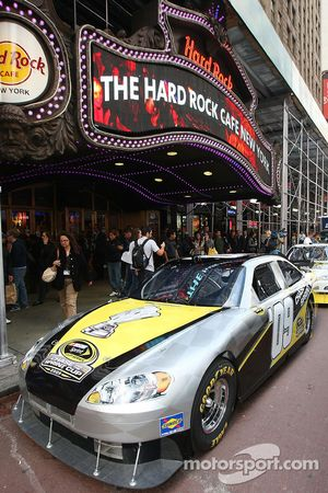 A NASCAR Sprint Cup Series car parks in front of the Hard Rock Cafe
