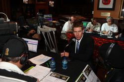 NASCAR Sprint Cup Series driver Carl Edwards goes live on the air on Radio Row Thursday at the Hard Rock Cafe