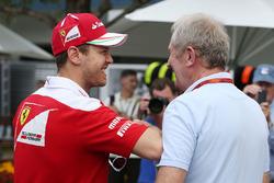 Sebastian Vettel, Ferrari with Dr Helmut Marko, Red Bull Motorsport Consultant