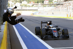 McLaren team members congratulate Fernando Alonso, McLaren MP4-31 on his sixth place finish