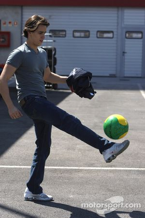 Diego Nunes plays football in the paddock