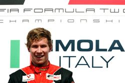 Race winner Kazim Vasiliauskas celebrates on the podium